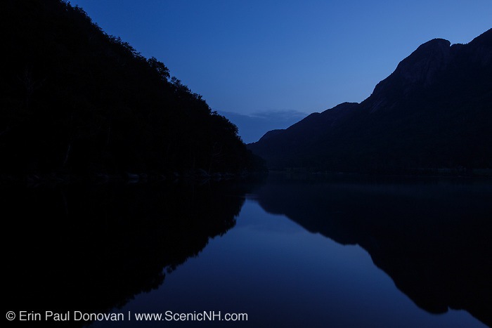 Franconia Notch State Park - Silhouette of Eagle Cliff at twilight from Profile Lake in the White Mountains, New Hampshire USA during the summer months.