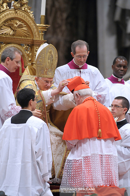 German newly appointed Cardinal Walter Brandmueller (R) gets his biretta, the square red hat symbolising the blood of the martyrs, from Pope Benedict XVI (L) on November 20, 2010 during a consistory at St Peter's basilica at The Vatican. 24 Roman Catholic prelates joined today the Vatican's College of Cardinals, the elite body that advises the pontiff and elects his successor upon his death.