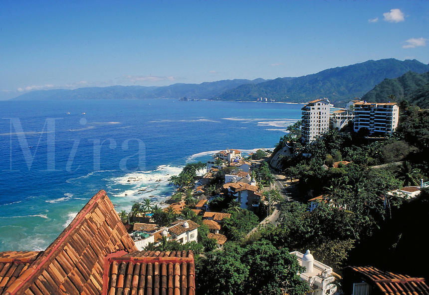 scenic overview of coastline at Puerta Vallarta, Mexico showing tile roofs and turquoise colored water. Puerto Vallarta, Mexico.