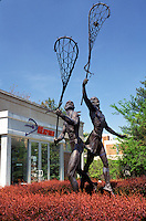 Lacrosse, Hall of Fame, Baltimore, US Lacrosse Hall of Fame Museum, Maryland, Statue of Indians playing Lacrosse in front of the US Lacrosse Hall of Fame Museum.