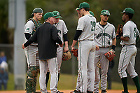Dartmouth Big Green head coach Bob Whalen talks with pitcher Jack Metzger (29), catcher Ben Rice (9), third baseman Justin Murray (5), shortstop Bryce Daniel (4), and second baseman Blake Crossing (13) during a game against the Indiana State Sycamores on February 21, 2020 at North Charlotte Regional Park in Port Charlotte, Florida.  Indiana State defeated Dartmouth 1-0.  (Mike Janes/Four Seam Images)