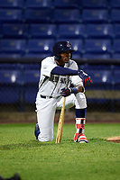 Binghamton Rumble Ponies center fielder Champ Stuart (2) kneels while a teammate is checked out by the trainer during a game against the Altoona Curve on May 17, 2017 at NYSEG Stadium in Binghamton, New York.  Altoona defeated Binghamton 8-6.  (Mike Janes/Four Seam Images)
