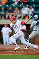 Greeneville Reds shortstop Miguel Hernandez (33) hits an RBI double in front of catcher Carlos Narvaez (48) during a game against the Pulaski Yankees on July 27, 2018 at Pioneer Park in Tusculum, Tennessee.  Greeneville defeated Pulaski 3-2.  (Mike Janes/Four Seam Images)