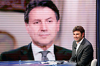 Former deputy of Movement 5 Stars and writer Alessandro Di Battista appears as a guest on the talk show Porta a Porta to present his new book 'Contro'. In the background, on the screen, Giuseppe Conte.<br /> Rome (Italy), May 25th 2021<br /> Photo Samantha Zucchi Insidefoto