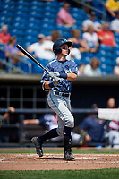 West Michigan Whitecaps second baseman Kody Clemens (21) follows through on a swing during a game against the Quad Cities River Bandits on July 23, 2018 at Modern Woodmen Park in Davenport, Iowa.  Quad Cities defeated West Michigan 7-4.  (Mike Janes/Four Seam Images)