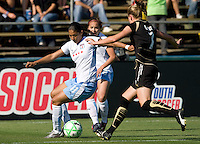07 June 2009: Cristiane of the Red Stars dribbles the ball away from Leigh Ann Robinson of the FC Gold Pride during the game at Buck Shaw Stadium in Santa Clara, California.   FC Gold Pride tied Chicago Red Stars, 1-1.