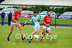 Kevin Goulding of Ballyduff goal bound as Matthew O'Sullivan and Emmet Curran of St Michaels Foilmore try to close him down in the County Senior football league.