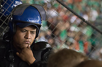 MEXICO CITY, MEXICO - June 11, 2017: A Mexico police officer separates the USA fans attending the World Cup Qualifier match against Mexico at Azteca Stadium.