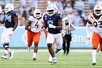 CHAPEL HILL, NC - OCTOBER 10: Michael Carter #8 of North Carolina runs 62 yards for a touchdown during a game between Virginia Tech and North Carolina at Kenan Memorial Stadium on October 10, 2020 in Chapel Hill, North Carolina.