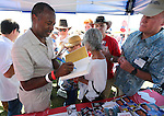 Republican presidential candidate Dr. Ben Carson autographs his book for supporters at the Inaugural Basque Fry in Gardnerville, Nev., on Saturday, Aug. 15, 2015. <br /> Photo by Cathleen Allison