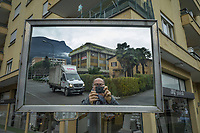 Switzerland. Canton Ticino. Lugano. Truck on the road. Street mirror. Self-portrait with the Ricoh GR III. A self-portrait is a representation of an artist that is photographed by that artist. 21.12.2020 © 2020 Didier Ruef