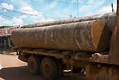 Pará State, Brazil. São Félix do Xingu. Battered logging truck driving through the town.