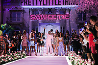MANHATTAN, NEW YORK CITY, NEW YORK, USA - SEPTEMBER 08: Rapper Saweetie and Umar Kamani onstage at the PrettyLittleThing x Saweetie runway show during New York Fashion Week: The Shows held at The Plaza Hotel on September 8, 2019 in Manhattan, New York City, New York, United States.