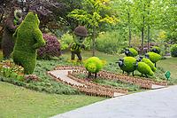 Yangzhou, Jiangsu, China.  Humorous Figures in the Flower Garden in the Slender West Lake Park.