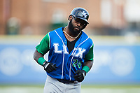 Courtney Hawkins (24) of the Lexington Legends rounds the bases after hitting a home run against the High Point Rockers at Truist Point on June 16, 2021, in High Point, North Carolina. The Legends defeated the Rockers 2-1. (Brian Westerholt/Four Seam Images)