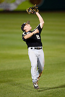 David Miller (29) of the Purdue Boilermakers catches a fly ball hit to shallow left field during a game against the Missouri State Bears at Hammons Field on March 13, 2012 in Springfield, Missouri. (David Welker / Four Seam Images)