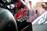 Aug 9, 2020; Clermont, Indiana, USA; Detailed view of carbon fiber header pipe covers on the dragster of NHRA top fuel driver Steve Torrence during the Indy Nationals at Lucas Oil Raceway. Mandatory Credit: Mark J. Rebilas-USA TODAY Sports