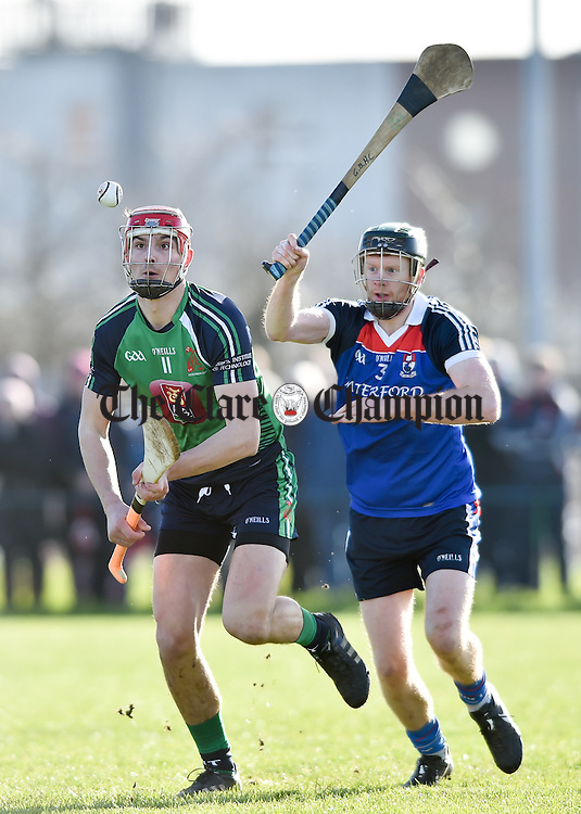 Peter Duggan of LIT in action against Ger Teehan of WIT during their Fitzgibbon Cup quarter-final in Limerick. Photograph by John Kelly.