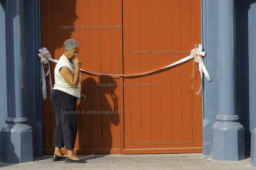 Volunteers are fixing the ribbon an hour before the official opening ceremony of ST. Petrus and Paulus Cathedral (AKA World's largest wooden cathedral)