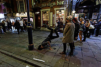 Pictured: A man does a breakdance move in Swansea. Tuesday 31 December 2019 to Wednesday 01 January 2020<br /> Re: Revellers on a night out for New Year's Eve in Wind Street, Swansea, Wales, UK.