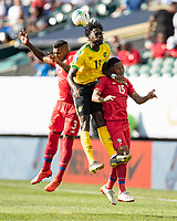 PHILADELPHIA, PA - JUNE 30: Eric Davis #15, Harold Cummings #3 and Shamar Nicholson #11 battle for a header during a game between Panama and Jamaica at Lincoln Financial Field on June 30, 2019 in Philadelphia, Pennsylvania.