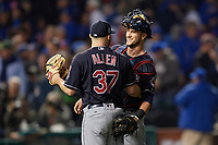 Cleveland Indians pitcher Cody Allen (37) celebrates with catcher Yan Gomes (10) after closing out Game 3 of the Major League Baseball World Series against the Chicago Cubs on October 28, 2016 at Wrigley Field in Chicago, Illinois.  (Mike Janes/Four Seam Images)