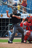 Umpire Joey Amaral makes a strike call during a game between the Pawtucket Red Sox and Syracuse Chiefs on July 6, 2015 at NBT Bank Stadium in Syracuse, New York.  Syracuse defeated Pawtucket 3-2.  (Mike Janes/Four Seam Images)