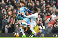 Swansea City's Leroy Fer and Manchester City's Gabriel Jesus battle for possession during the Premier League match between Manchester City and Swansea City at the Etihad Stadium, Manchester, England. Sunday 05 February 2017