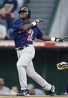 Cristian Guzman of the Minnesota Twins bats during a 2002 MLB season game against the Los Angeles Angels at Angel Stadium, in Anaheim, California. (Larry Goren/Four Seam Images)