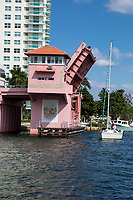 Ft. Lauderdale, Florida.  SE 3rd. Street Draw Bridge Opens over New River to Let a Tall-masted Sail Boat Pass.