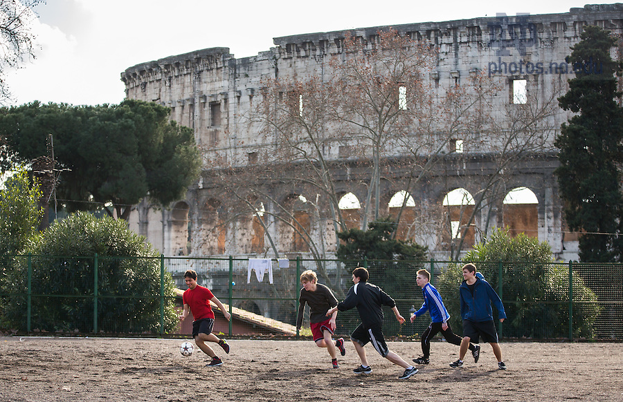 Jan. 28, 2014; Undergraduate School of Architecture students (from left to right) Eduardo Oronia, Andrew Packey, Chris Lattimer, Joseph Abbamonte, and Michael Langer play soccer next to the Colosseum, near the Notre Dame Rome Centre.<br /> <br /> Photo by Matt Cashore/University of Notre Dame