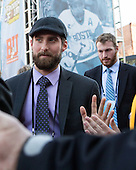 Anthony Moccia (BU - 1), JD Carrabino (BU - 23) - The teams walked the red carpet through the Fan Fest outside TD Garden prior to the Frozen Four final on Saturday, April 11, 2015, in Boston, Massachusetts.