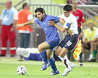 Claudio Reyna of the USA tries to slow up  Gennaro Gattuso of Italy.The USA and Italy played to a 1-1 tie in their FIFA World Cup Group E match at Fritz-Walter-Stadion, Kaiserslautern, Germany, June 17, 2006.