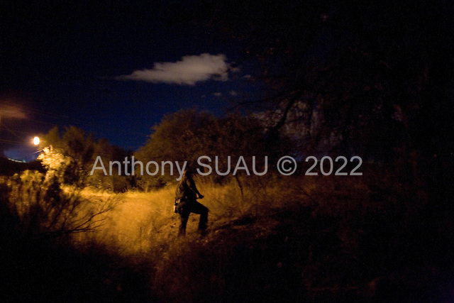 Nogales, Arizona.USA.October 24, 2006..The US Border Patrol enters a field in search for a group of Mexicans that had jump the fence entering the USA illegally at the border between Nogales, US and Nogales, Mexico...The Mexicans crossing the border could be seen clearly by a camera tower with night vision. The information as to their movements are radioed to the Border Patrol but the Mexicans run back and jump the fence into Mexico before they are detained.