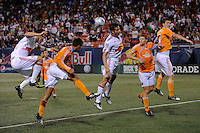 Sinisa Ubiparipovic (8) and Mike Petke (12) of the New York Red Bulls battle for a header with Chris Wondolowski, Andrew Hainault (31), and Bobby Boswell (32) of the Houston Dynamo in front of the Dynamo goal late in the game. The New York Red Bulls and the Houston Dynamo played to a 1-1 tie during a Major League Soccer match at Giants Stadium in East Rutherford, NJ, on May 16, 2009.