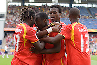 Ghana's Haminu Draman (23) is congratulated by teamates after scoring a goal against the USA in the first half. Ghana defeated the USA 2-1 in their FIFA World Cup Group E match at Franken-Stadion, Nuremberg, Germany, June 22, 2006. Ghana advances to round of 16 and the USA is out of the tournament.