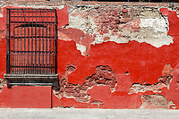 Antigua, Guatemala.  Old Building, Window Grill, Blocked-up Window, Falling Plaster.  Semana Santa.