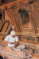 Bhaktapur, Nepal.  Woodworker at Work, Making a Door Frame.