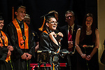 TERRYVILLE, CT- 8 June 2016-060816EC11-  Kayla Nicole Ireland receives applause as she is able to walk and receive her diploma during Terryville High School's graduation Wednesday night. Ireland, who also made National Honor Society, has Cerebral Palsy. Erin Covey Republican-American