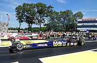 Jun. 3, 2012; Englishtown, NJ, USA: NHRA top fuel dragster driver Brandon Bernstein (near lane) races alongside David Grubnic during the Supernationals at Raceway Park. Mandatory Credit: Mark J. Rebilas-