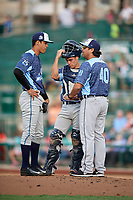 West Michigan Whitecaps starting pitcher Jesus Rodriguez (5) in a mound visit with pitching coach Jorge Cordova (40) and catcher Brady Policelli (6) during a game against the Fort Wayne TinCaps on May 17, 2018 at Parkview Field in Fort Wayne, Indiana.  Fort Wayne defeated West Michigan 7-3.  (Mike Janes/Four Seam Images)