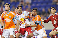 Juan Pablo Angel (9) of the New York Red Bulls and Brian Ching (25) of the Houston Dynamo fight for position on a corner kick. The New York Red Bulls defeated the Houston Dynamo 2-1 during a Major League Soccer (MLS) match at Red Bull Arena in Harrison, NJ, on June 2, 2010.