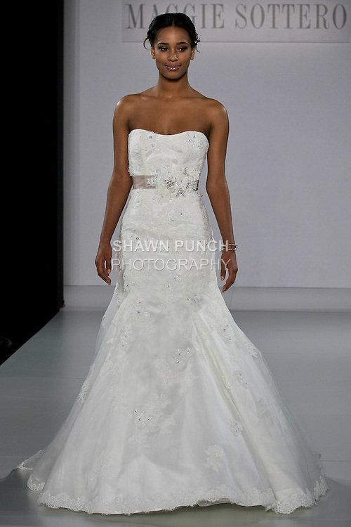 Model walks runway in a Hartley wedding dress from the Sottero and Midgley Spring 2013 collection, at The Couture Show, during New York Bridal Fashion Week, on October 14, 2012.