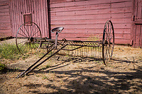 Farming has always been hard work.  An antique horse-drawn hay rake on display in front of the red barn that serves as the vistor center at Garin Regional Park, Hayward, California.