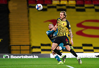 Ben Wilmot of Watford holds off Emi Buendía of Norwich City during the Sky Bet Championship behind closed doors match played without supporters with the town in tier 4 of the government covid-19 restrictions, between Watford and Norwich City at Vicarage Road, Watford, England on 26 December 2020. Photo by Andy Rowland.