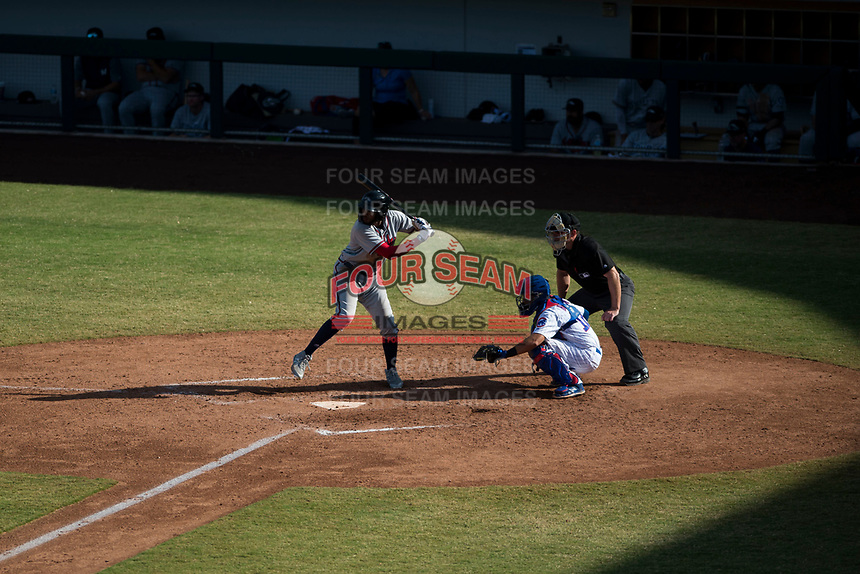 Peoria Javelinas right fielder Izzy Wilson (7), of the Atlanta Braves organization, at bat in front of catcher P.J. Higgins (12) and home plate umpire Bryan Fields during an Arizona Fall League game against the Mesa Solar Sox at Sloan Park on October 24, 2018 in Mesa, Arizona. Mesa defeated Peoria 4-3. (Zachary Lucy/Four Seam Images)