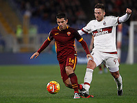 Calcio, Serie A: Roma vs Milan. Roma, stadio Olimpico, 9 gennaio 2016.<br /> Roma's Iago Falque, left, is challenged by AC Milan's Andrea Bertolacci during the Italian Serie A football match between Roma and Milan at Rome's Olympic stadium, 9 January 2016.<br /> UPDATE IMAGES PRESS/Isabella Bonotto