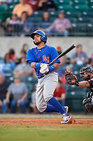 Midland RockHounds catcher Argenis Raga (8) follows through on a swing during a game against the Arkansas Travelers on May 25, 2017 at Dickey-Stephens Park in Little Rock, Arkansas.  Midland defeated Arkansas 8-1.  (Mike Janes/Four Seam Images)