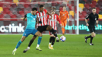 Brentford's Ethan Pinnock in possession under pressure from AFC Bournemouth's Dominic Solanke during Brentford vs AFC Bournemouth, Sky Bet EFL Championship Football at the Brentford Community Stadium on 30th December 2020