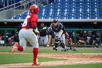 New York Yankees Jason Lopez (71) looks to flip the ball to the pitcher covering home as Reginald Wilson (23) scores a run during an instructional league game against the Philadelphia Phillies on September 29, 2015 at Brighthouse Field in Clearwater, Florida.  (Mike Janes/Four Seam Images)